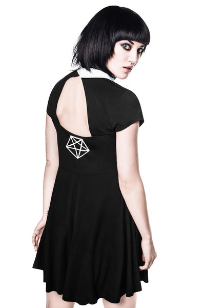 Back of girl wearing black goth bad habits skater dress