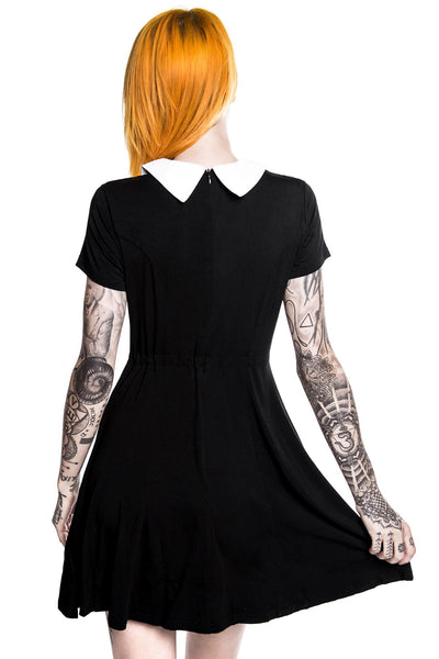 back of model wearing black goth doll dress from killstar