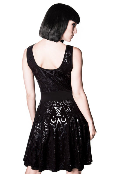 Back of girl wearing gothic vicky veil skater dress from KILLSTAR