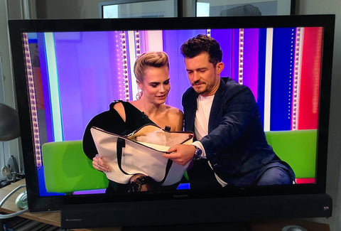 wyatt and jack cara delivigne orlando bloom the one show flamingo bag