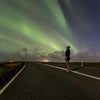 man watching Northern lights tour iceland