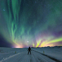 man watching Northern lights tour iceland aurora borealis
