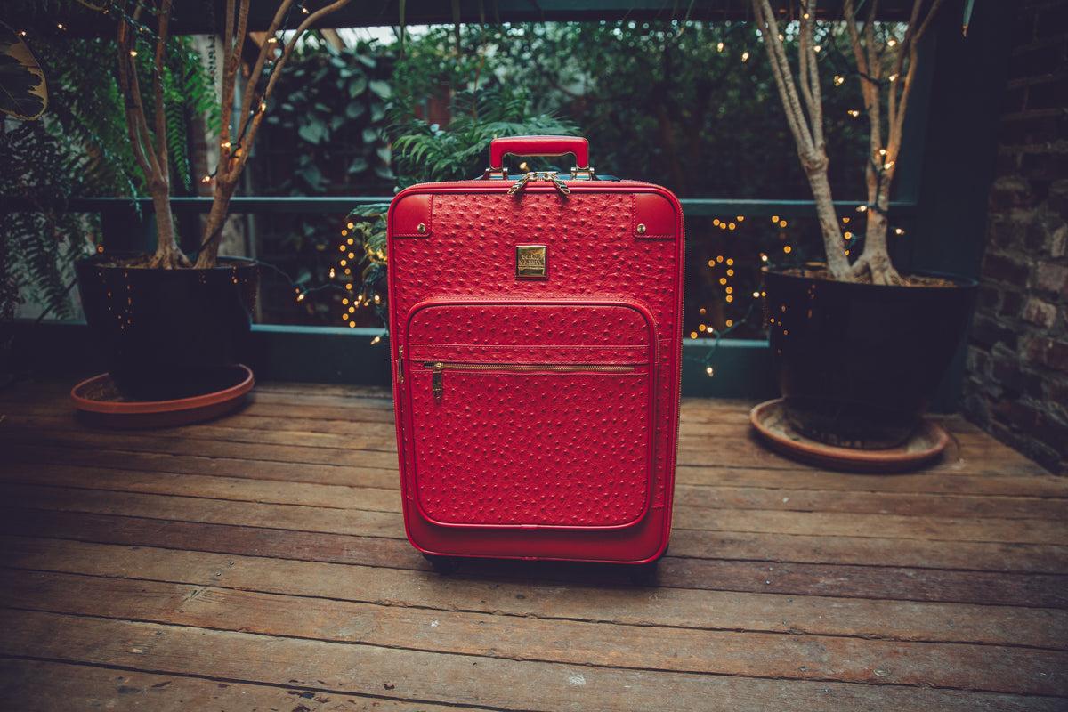 The Crown Collection Red Roller Luggage