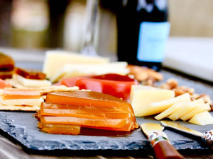 Cheese board with assorted cheeses, Hawaii Fruit Pastes and crackers. Gourmet Cheese condiments