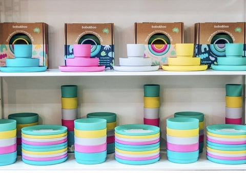 Plant based plate and bowl set displayed on shelves