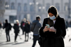 Public walking with masks on to avoid coronavirus covid-19
