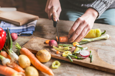 Person cutting organic vegetables
