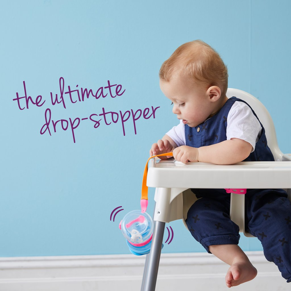 Baby bottle connected to a strap and hanging off a baby chair
