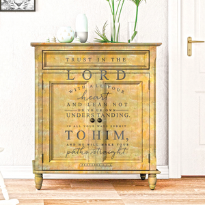 On a yellow-painted small cabinet there is a decal that says: rust in the Lord with all your heart and lean not on your own understanding. In all your ways submit to him and he will make your paths straight. Proverbs 3 : 5 - 6.
