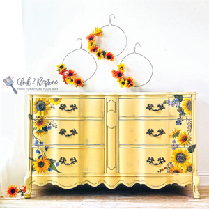 dresser with sunflower molds and sunflower decals on it.