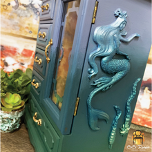 Load image into Gallery viewer, mermaid silicone mold by redesign with prima on a jewelry cabinet