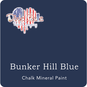 Dark blue colored paint sample. Dixie Belle logo on the top left hand corner. Text on bottom: Bunker Hill Blue, chalk mineral paint