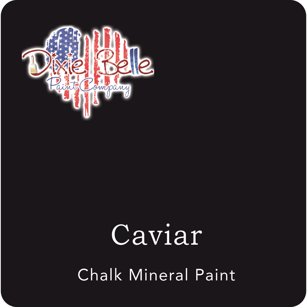 "A pitch black swatch in a square shape with rounded corners. At the bottom, and centered inside of the swatch, are the words: Caviar. Chalk Mineral Paint. And on the upper left hand corner, inside of the swatch is the word ""Maika Daughters"" and the logo for Dixie Belle Paint Company in the shape of a heart with the colors of the American Flag."