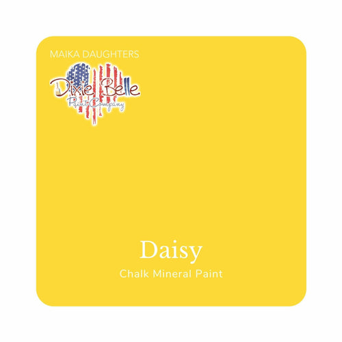 "A bright medium yellow swatch in a square shape with rounded corners. At the bottom, and centered inside of the swatch, are the words: Daisy. Chalk Mineral Paint. And on the upper left hand corner, inside of the swatch is the word ""Maika Daughters"" and the logo for Dixie Belle Paint Company in the shape of a heart with the colors of the American Flag."