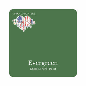 "A medium green swatch in a square shape with rounded corners. At the bottom, and centered inside of the swatch, are the words: Evergreen. Chalk Mineral Paint. And on the upper left hand corner, inside of the swatch is the word ""Maika Daughters"" and the logo for Dixie Belle Paint Company in the shape of a heart with the colors of the American Flag."