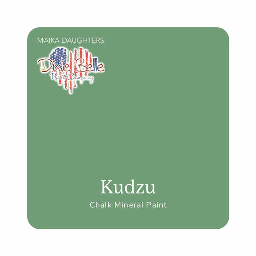 "A leafy green swatch in a square shape with rounded corners. At the bottom, and centered inside of the swatch, are the words: Kudzu. Chalk Mineral Paint. And on the upper left hand corner, inside of the swatch is the word ""Maika Daughters"" and the logo for Dixie Belle Paint Company in the shape of a heart with the colors of the American Flag."