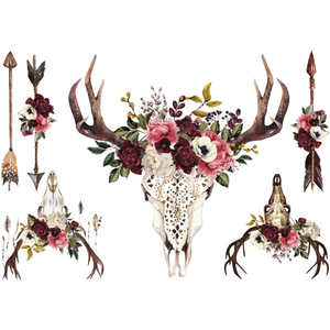 Beautifully Native furniture decal. One large deer skull with lace etched on the skull, and a cluster flowers  in burgundy, pink and white sitting on its head. Two smaller skulls with flowers on the  head, and 3 arrows. Two of the arrows have flowers bunch on one side of the arrow.