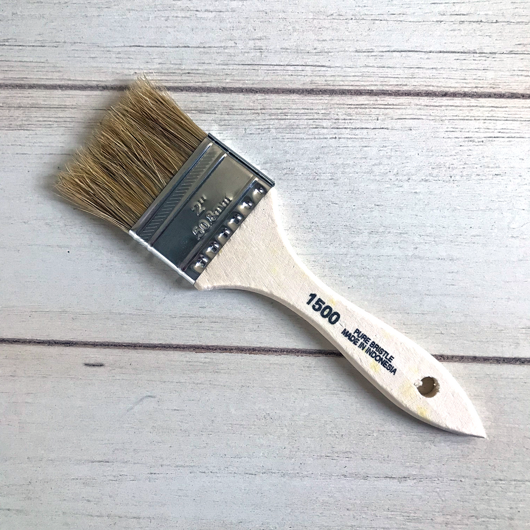 An arial view of a paint brush on a table. On it, it say 2