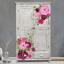 Load image into Gallery viewer, Large bold pink toned flower decals placed on an armoire painted gray.