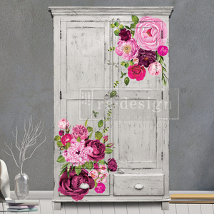 Large bold pink toned flower decals placed on an armoire painted gray.