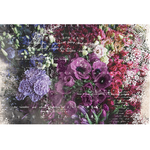 This decoupage paper by ReDesign with Prima has bundles of purple flowers, lavender flowers and burgundy flowers. On the right edge of the paper there is white lace, and over the entire image there are words overlaid in white.