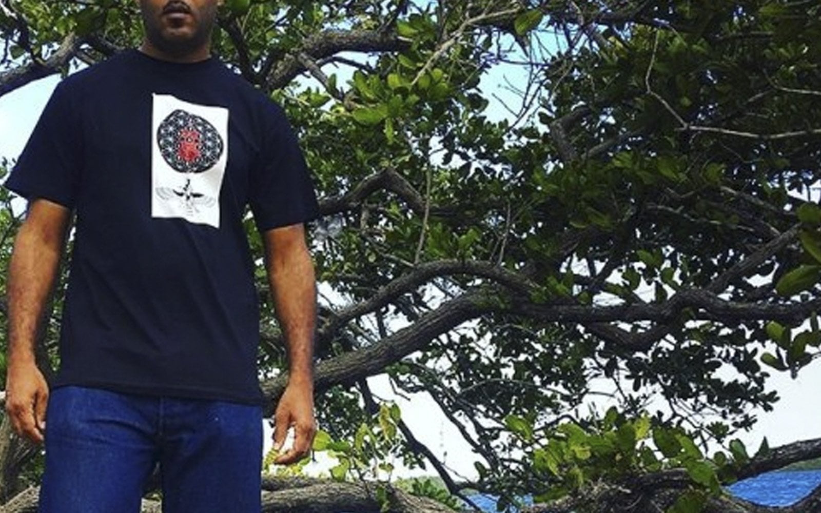 Annunaki Blood Tee in Black. Kenya Standing on the Banks of the Euphrates and Tigris rivers
