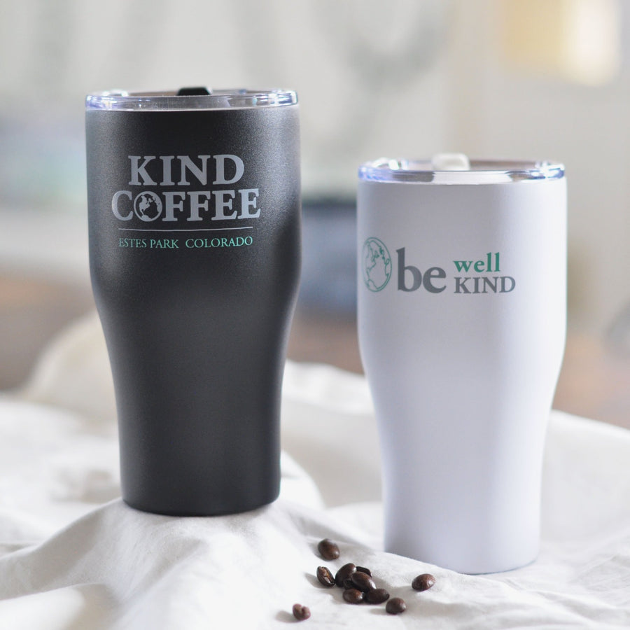 "Travel mug says ""be well, be kind"" on front, and ""Kind Coffee Estes Park"" on back"