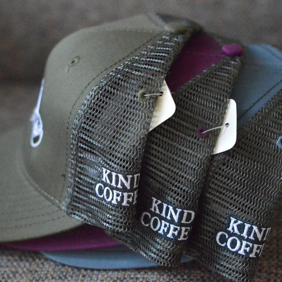 "Side of mesh hat says ""Kind Coffee"""