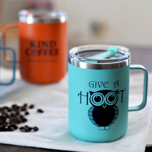 "Front of teal mug, owl graphic, ""Give a Hoot"""
