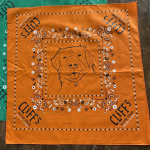 "Orange bandana, ""Cliff's Scoop Shop"", Clifford the dog's face in the center"
