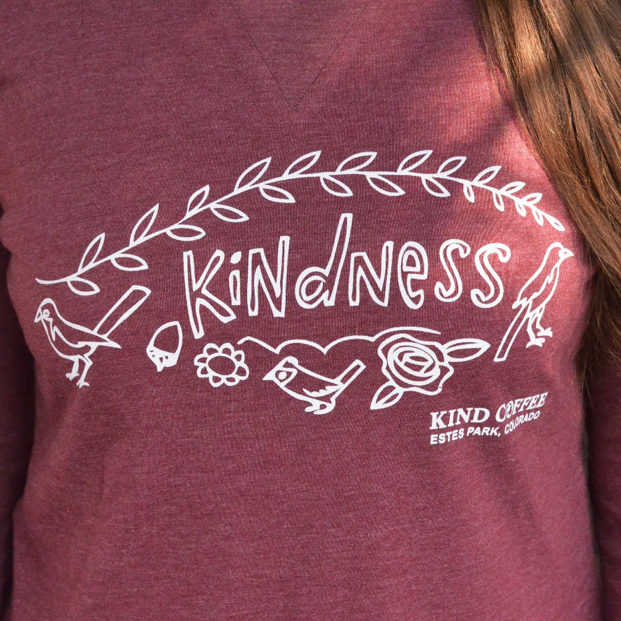 "Red long sleeve shirt, ""Kindness"" and ""Kind Coffee, Estes Park Colorado"", drawings of birds and flowers"