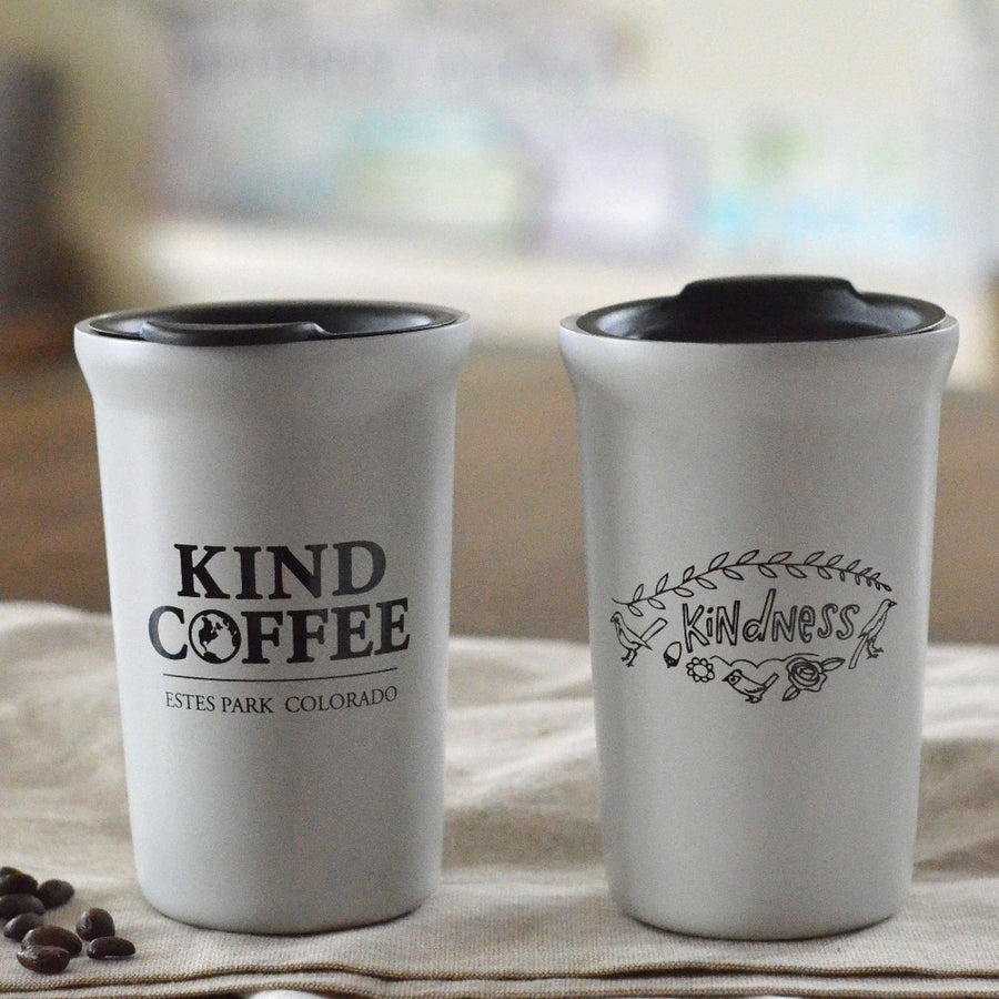 "White mug with black wording ""Kindness"" on front and ""Kind Coffee Estes Park, Colorado"""