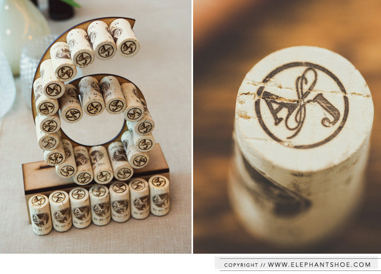 Custom monogram corks and corked wooden table numbers // Photo by: 1. Ian Mitchinson 2. Blackframe Photography