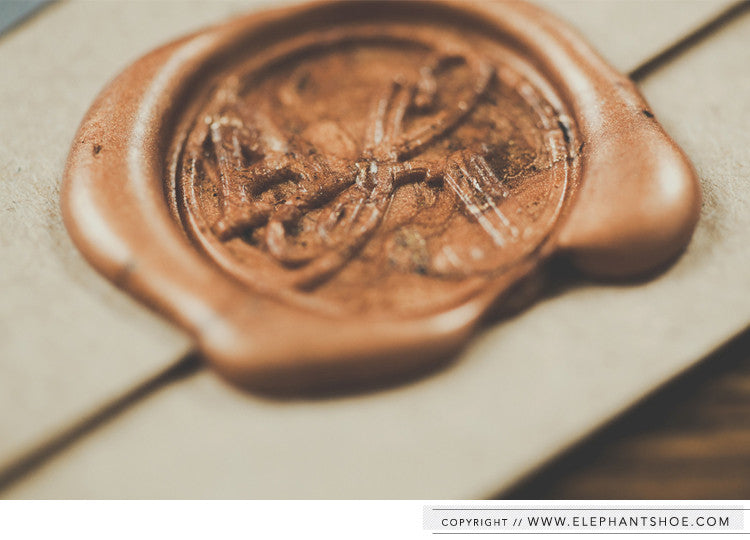 Custom copper wax seal // Photo by: Blackframe Photography