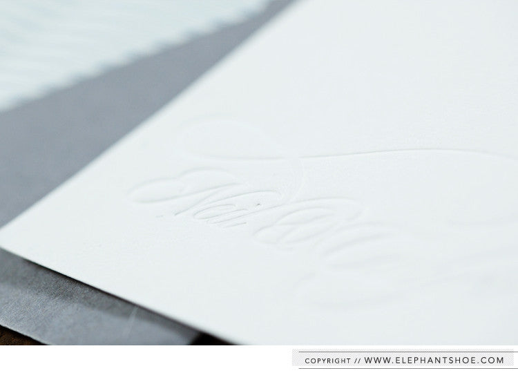 Blind deboss letterpress thank-you cards in grey lined envelopes // Photo by: Blackframe Photography