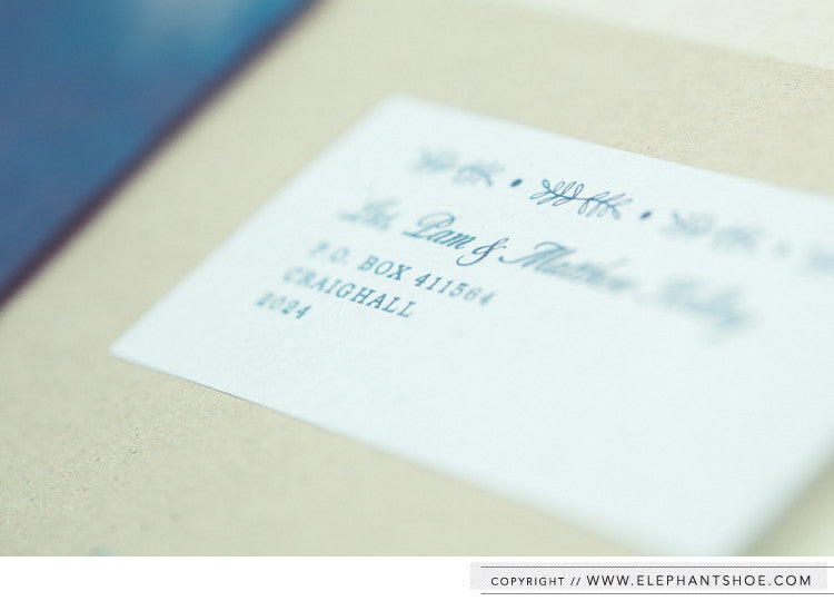 Personalised guest address stickers on kraft envelopes // Photo by: Blackframe Photography