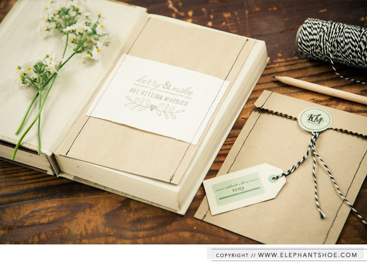 Kraft invitation pocket with canvas, sewing & stamp detail // Photo by: Blackframe Photography