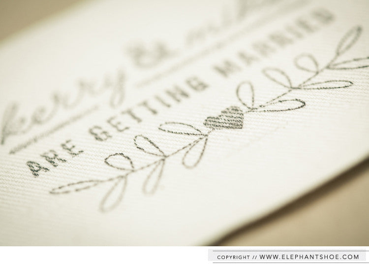 Canvas sewn into kraft pocket with stamp detail // Photo by: Blackframe Photography