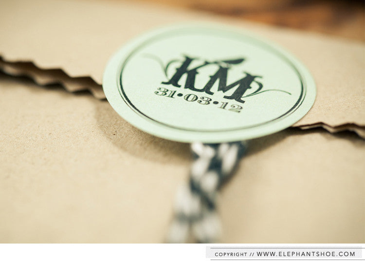 Monogram sticker to close each pocket with black and white bakers twine // Photo by: Blackframe Photography