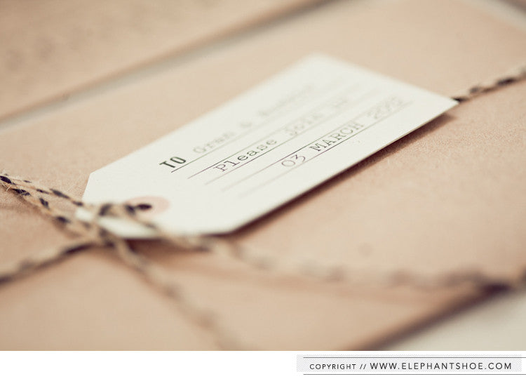 Guest luggage tag attached with black and natural twine // Photo by: Blackframe Photography