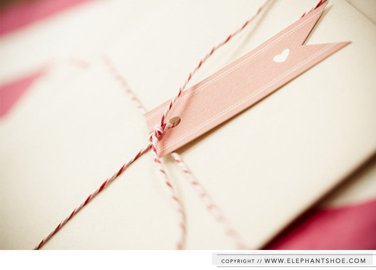 Guest name tag attached with pink bakers twine // Photo by: Blackframe Photography