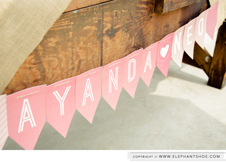 Paper bunting sign // Photo by: Blackframe Photography