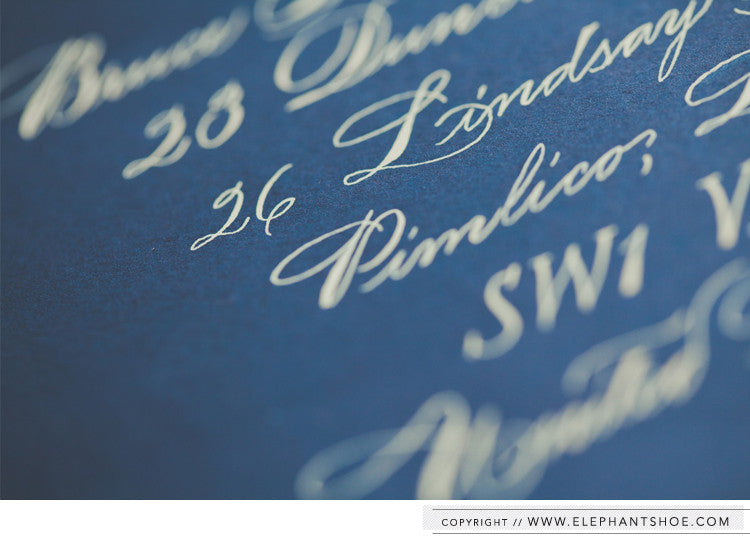 Calligraphy on navy envelopes // Photo By: Blackframe Photography