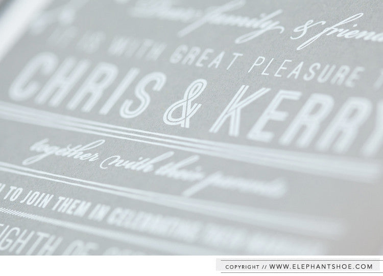 White screen printed on grey invitation // Photo By: Blackframe Photography