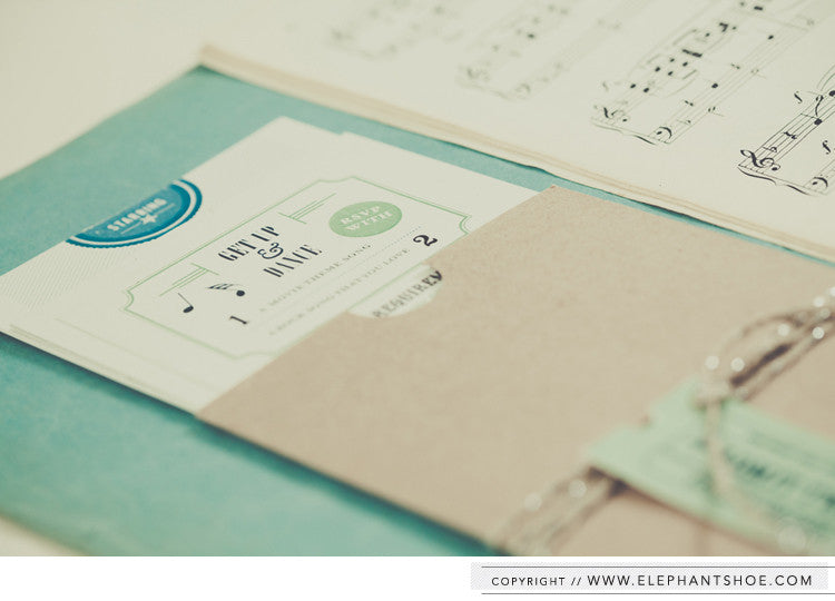 Story invitation with kraft pocket and tag // Photo by: Blackframe Photography