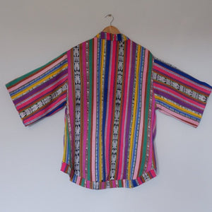 Brightly coloured jacket made from traditional Guatemalan fabric