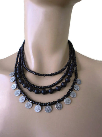 Black choker style necklace with lots of coins