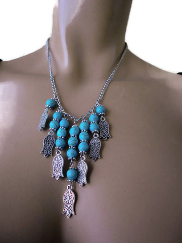 Bohemian necklace, turquoise stones and, hands of Fatima charms