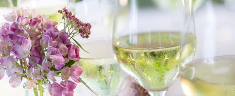white wine glasses with purple summer flowers