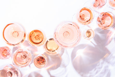 Many glasses of rose wine from above